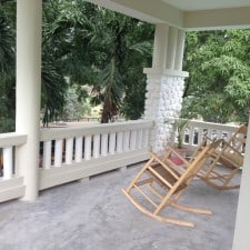 front porch with haitian rocking chairs